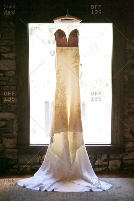 Lace wedding gown in window