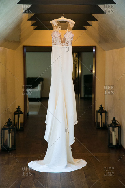 Wedding gown hanging in hall