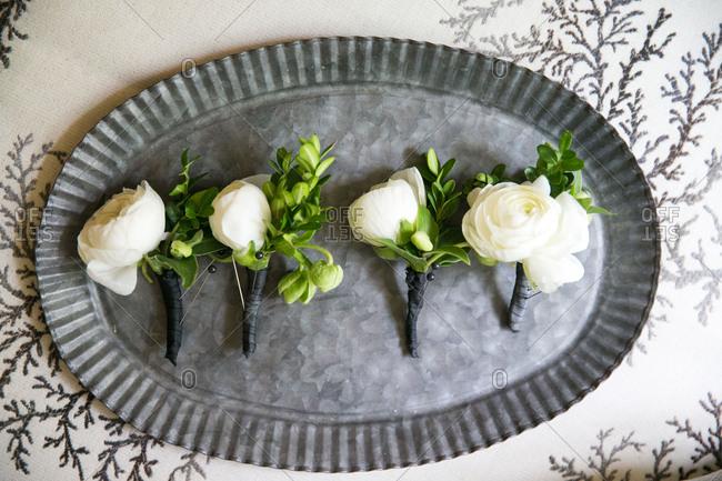 Rose boutonnieres on tray