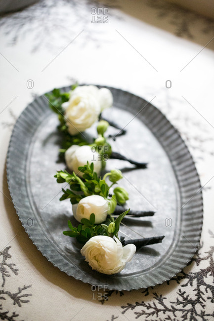 Rose boutonnieres on platter
