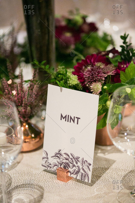 """Card on wedding table with word """"mint"""""""