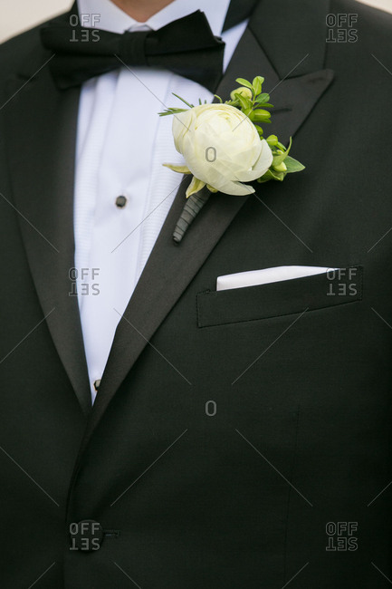 Groom in black tie and boutonniere