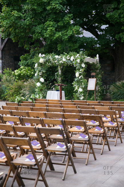 Chairs set up for outdoor wedding scene