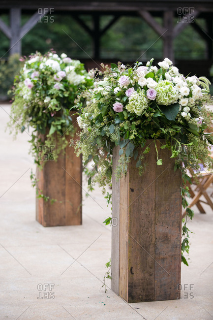 Flowers on posts for wedding