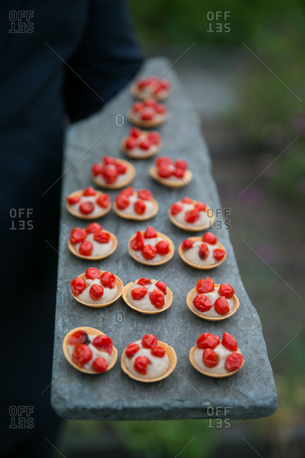 Caterer serving canap�s on slate