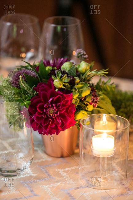 Flowers with candles on reception table