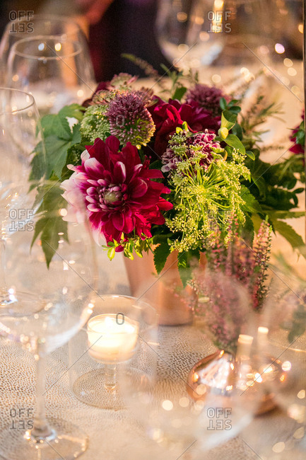 Tea lights and flowers decorating table