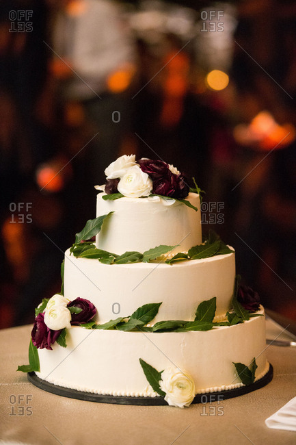 Wedding cake with roses at night