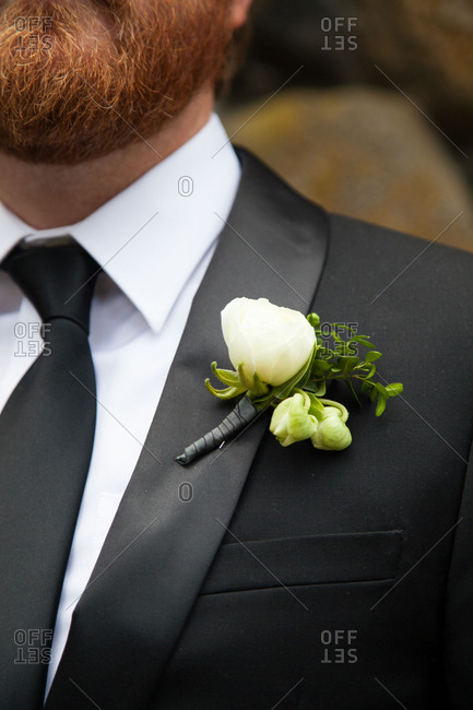 Bearded groom wearing boutonniere