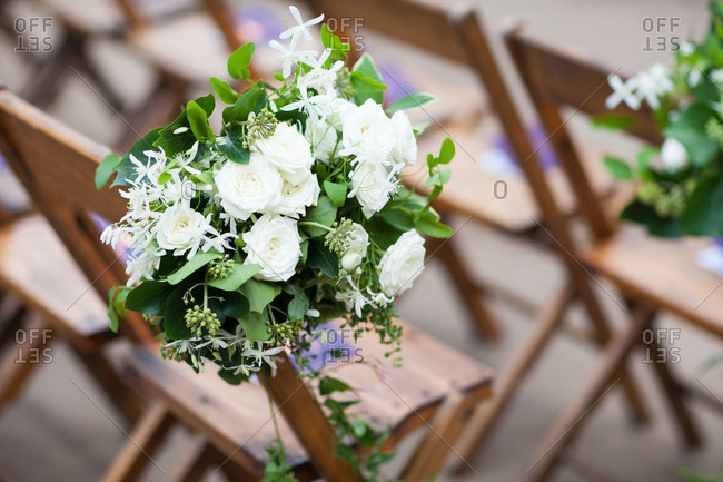 White roses on wedding chair