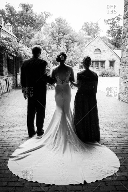 Parents with bride in silhouette
