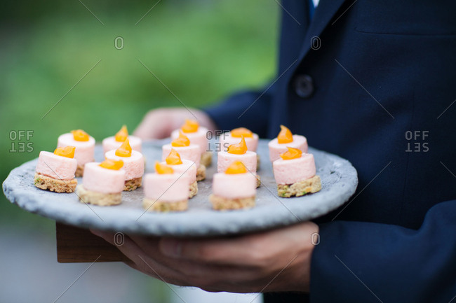 Person carrying hors d'oeuvres at wedding