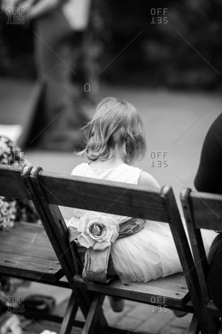 Flower girl in chair at wedding