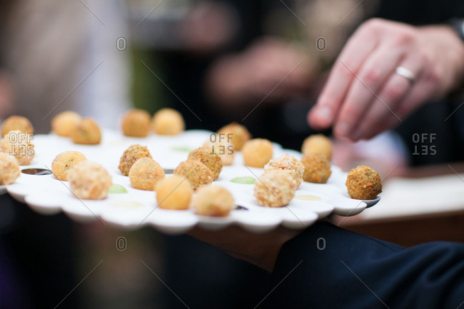 Wedding guest grabbing appetizer