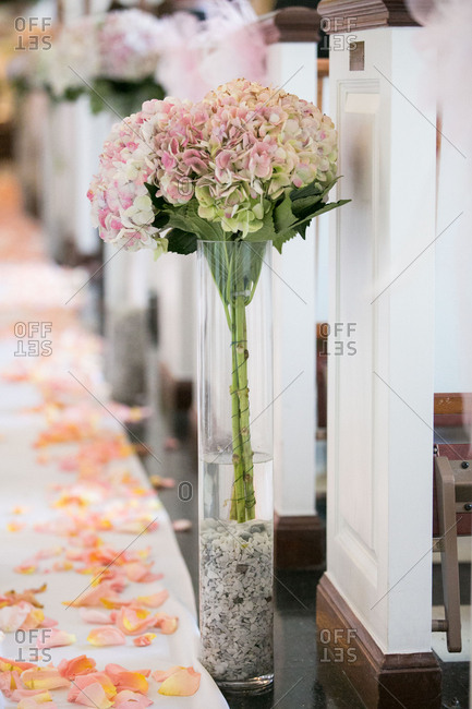 Flowers decorating aisle in church