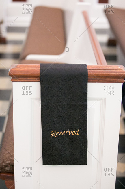 Reserved pew in church for wedding