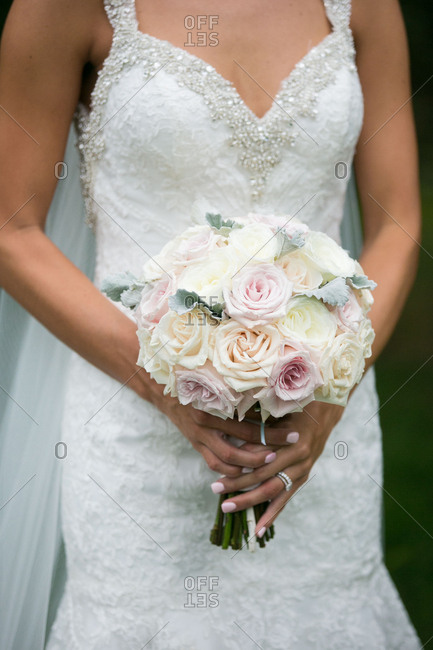 Bride holding white and pink bouquet