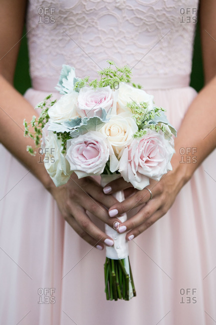 Bride with white and pink bouquet