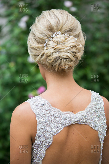 Blonde bride's hairstyle standing outside