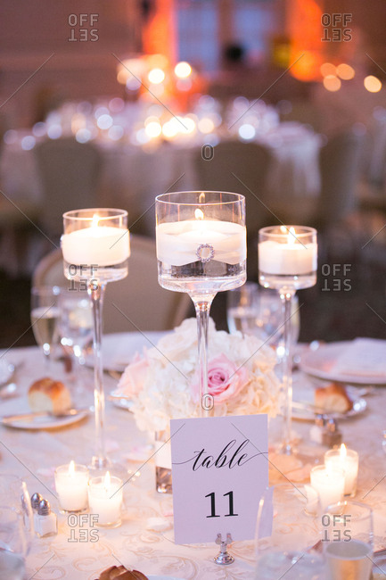 Tall candle holders on wedding table