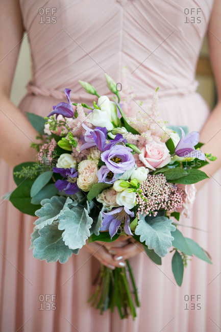 Bride with leafy bouquet
