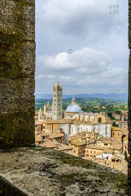 View of The Duomo and Campanile from Torre del Mangia in Palazzo Pubblico palace in Siena, Italy