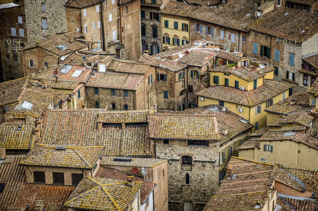 View of Siena rooftops from Torre del Mangia tower in Palazzo Publicco palace