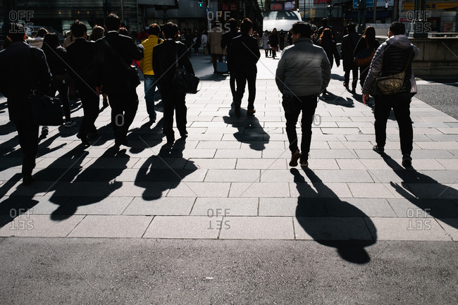 Osaka, Japan - January 17, 2017: Rear view of people walking on city street