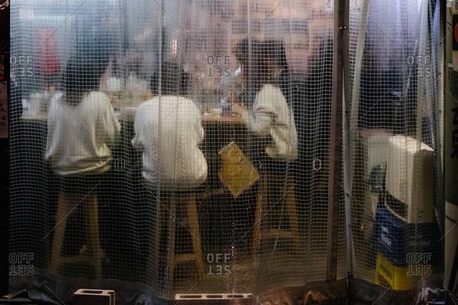 Transparent curtain on bar in Japan