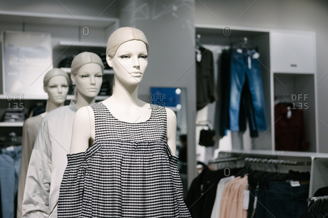 Mannequins in the window of a women's clothing store