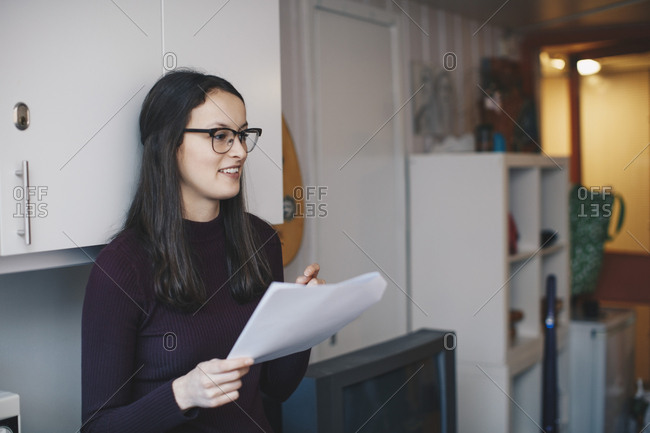 Happy woman studying in college dorm room