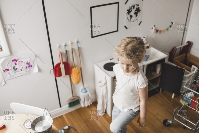 High angle view of girl walking in playroom at home