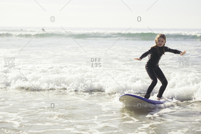 Full length of girl surfing in sea