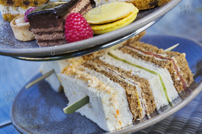 Close up of a selection of sandwiches and cakes, traditional afternoon tea