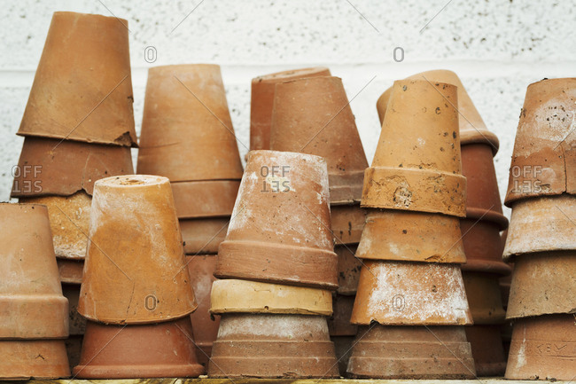 Close up of stacks of terracotta plant pots