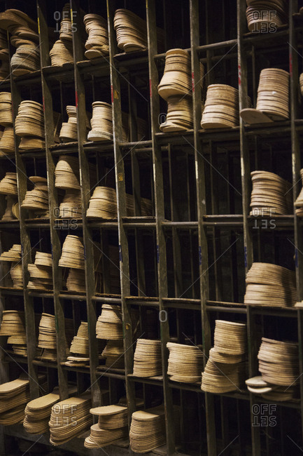 Close up of leather soles on shelves in a shoemaker's workshop