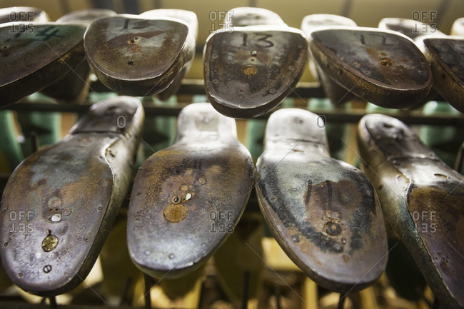 Close up of various metal shoe forms, wood and metal lasts, in a shoemaker's workshop