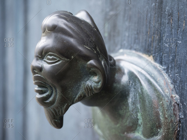 Venice A metal handle or knocker, a human or goblin head grimacing with an open mouth