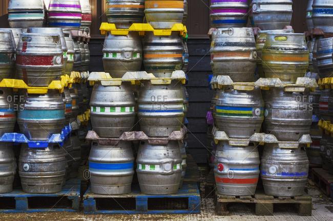 Stacks of metal beer kegs in a brewery
