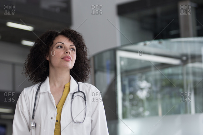 Portrait of Female Doctor walking through Hospital