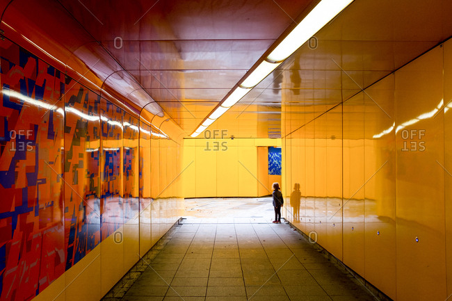 London, England - August 19, 2016: Child standing in a colorful tunnel in London