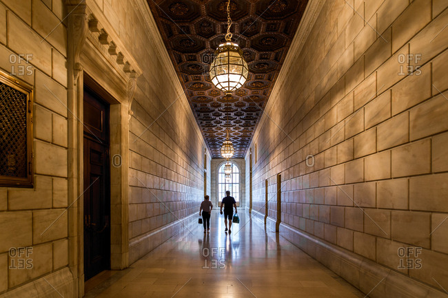 New York City, USA - September 2, 2016: People walking the halls of New York City Public Library