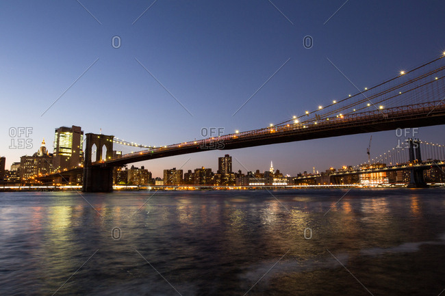 New York City, USA - September 12, 2016: Brooklyn Bridge and the view to Manhattan at dusk