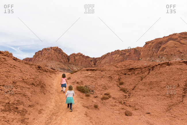 Two children climbing the trail at Capitol Reef NP, Utah