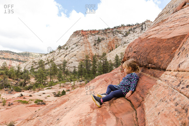 Young girl looking out over Zion National Park, Utah