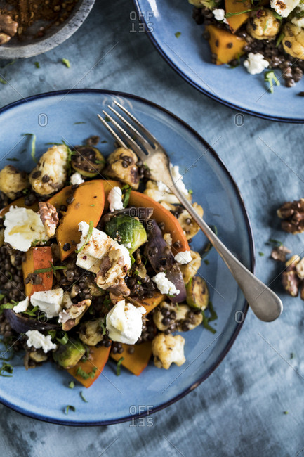 Roasted cauliflower, brussels sprouts, and pumpkin on a plate