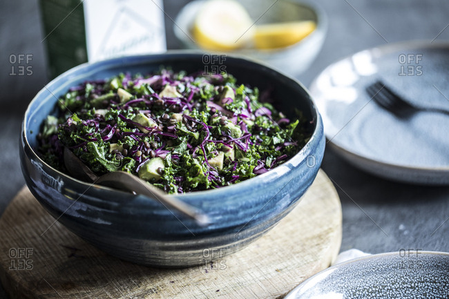 Chopped salad with kale, purple cabbage, avocado and lentils