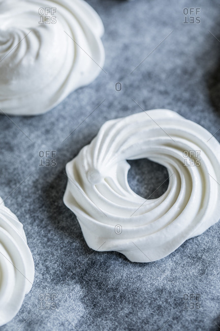Ring of swirled meringue on a baking sheet