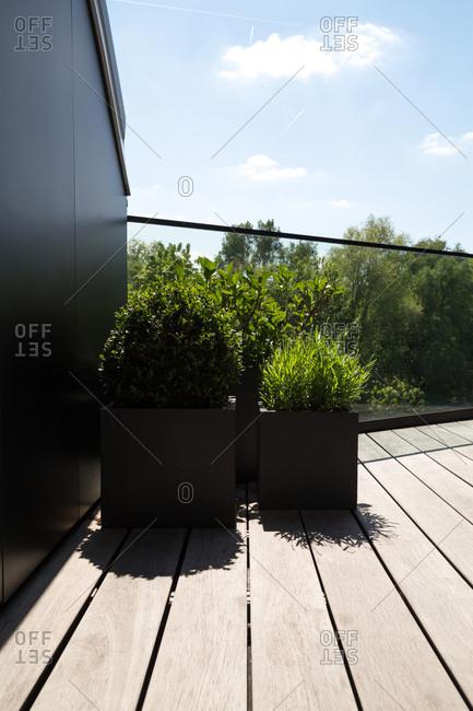 Large geometric planters on a modern terrace