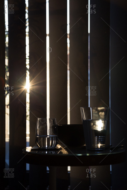 Glasses of water in dramatic light